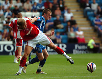 Photo: Tony Oudot.<br /> Gillingham v Charlton Athletic. Pre Season Friendly. 28/07/2007.<br /> Ben Thatcher of Charlton Athletic is tackled by Barry Cogan of Gillingham
