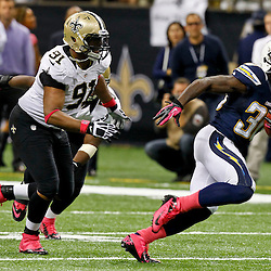 October 7, 2012; New Orleans, LA, USA; San Diego Chargers running back Ronnie Brown (30) breaks away from New Orleans Saints defensive end Will Smith (91) during the fourth quarter of a game at the Mercedes-Benz Superdome. The Saints defeated the Chargers 31-24. Mandatory Credit: Derick E. Hingle-US PRESSWIRE