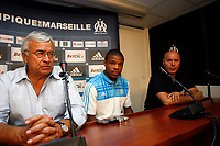 FOOTBALL - MISCS - FRENCH CHAMPIONSHIP 2010/2011 - OLYMPIQUE DE MARSEILLE - 24/08/2010 - PHOTO PHILIPPE LAURENSON / DPPI - LOIC REMY PRESS CONFERENCE FOR ANNOUNCED HIS APTITUDE FOR PLAY WITH MARSEILLE  WITH JEAN CLAUDE DASSIER (OM PRESIDENT) AND JOSE ANIGO (OM SPORT DIRECTOR)