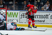 KELOWNA, CANADA - MARCH 3:  Schael Higson #21 of the Kelowna Rockets blocks a shot by Reece Newkirk #12 of the Portland Winterhawks on March 3, 2019 at Prospera Place in Kelowna, British Columbia, Canada.  (Photo by Marissa Baecker/Shoot the Breeze)