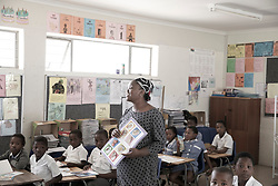 Primary school pupils and teachers. Learning in classroom. Cape Town, South Africa