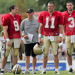 04 August 2009: Saints quarterbacks Drew Brees (9), Mark Brunell (11), and Joey Harrington (3) stand on the sideline for a special teams drill during New Orleans Saints training camp at the team's practice facility in Metairie, Louisiana.