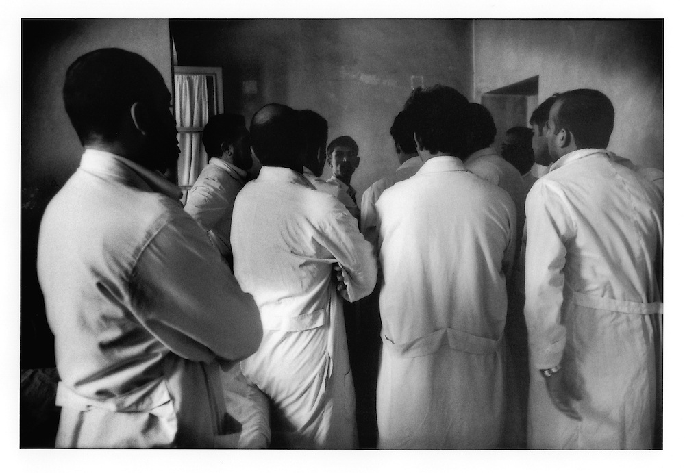 White coats.  Graduate medical students listen to colleague's analysis while at Kabul's only gov?t run mental hospital, Psychiatric and Drug Dependency Hospital, Kabul, Afghanistan.