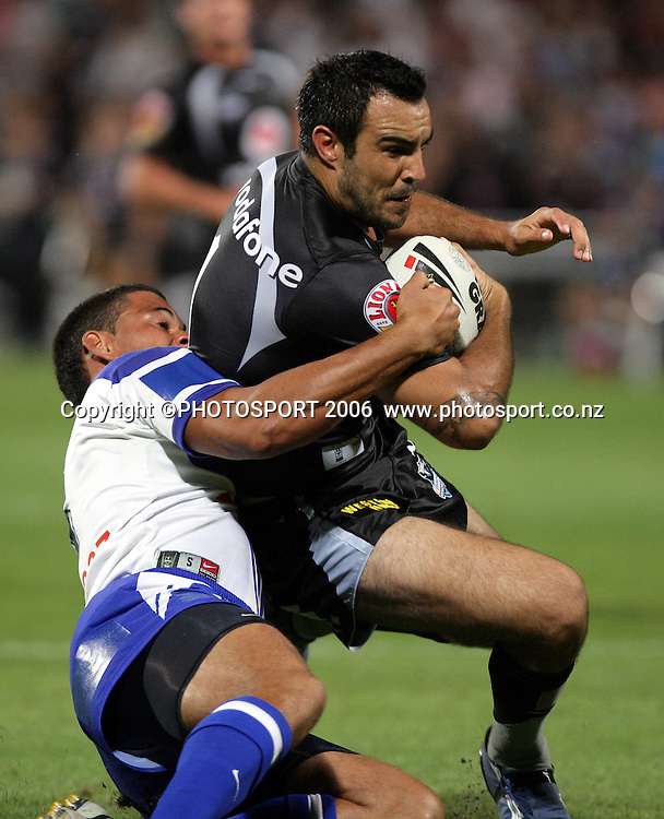 Warriors fullback Wade McKinnon is tackled at the pre season NRL match between the Warriors and Bulldogs at North Harbour Stadium, Auckland, New Zealand, on Saturday 3 March 2007. Photo: Andrew Cornaga/PHOTOSPORT