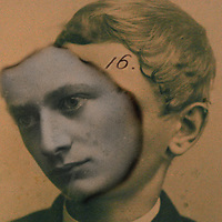 A young man with 16 on his forehead and facial features falling away