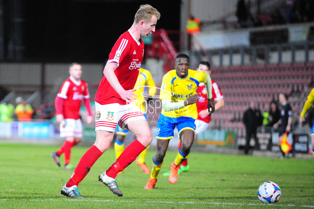 Mark Beck of Wrexham on loan from Yeovil Town clears during the Vanarama National League match between Wrexham AFC and Kidderminster Harriers at the Glyndŵr University Racecourse Stadium, Wrexham, United Kingdom on 23 February 2016. Photo by Mike Sheridan.