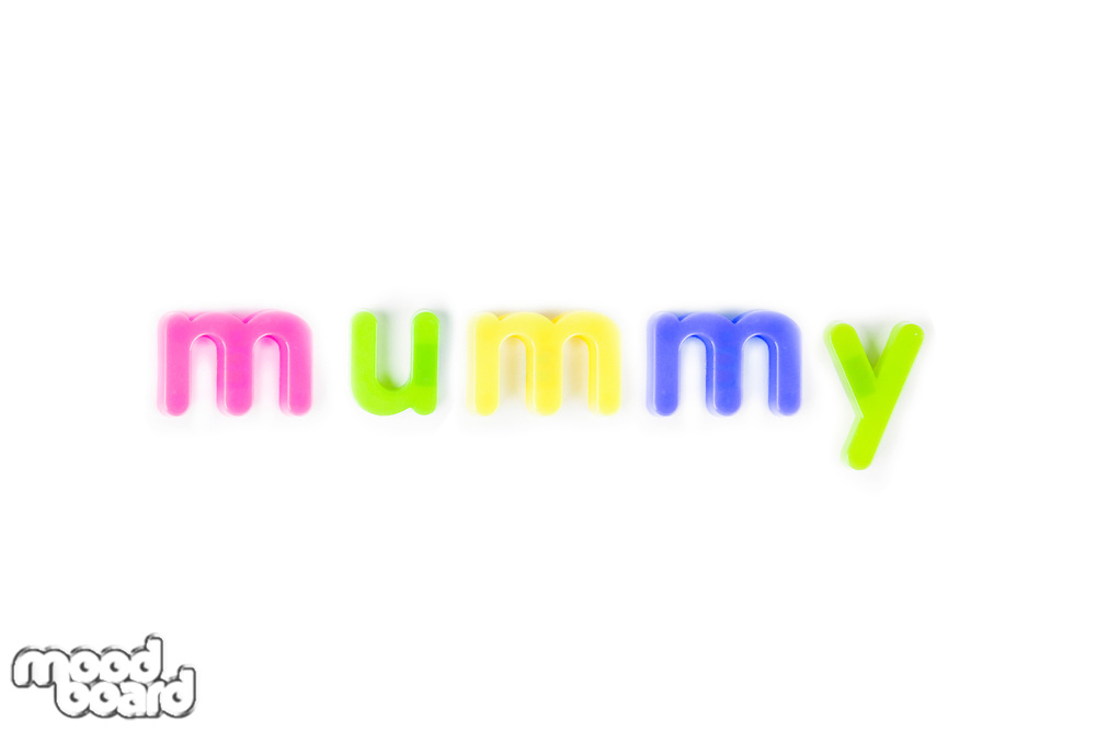 Colorful alphabet magnets spell 'mummy' over white background