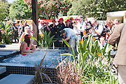 ANNA WATTS; CHARLEE LYN IN POND IN TRAILFINDERS GARDEN. SPONSORED BY FLEMINGS GARDEN CENTRE. Press view of the 2010 Chelsea Flower Show. Royal Hospital Rd. London. 24 May 2010. -DO NOT ARCHIVE-© Copyright Photograph by Dafydd Jones. 248 Clapham Rd. London SW9 0PZ. Tel 0207 820 0771. www.dafjones.com.