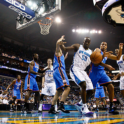 January 24,  2011; New Orleans, LA, USA; New Orleans Hornets center Emeka Okafor (50) and Oklahoma City Thunder center Nenad Krstic (12) and shooting guard Thabo Sefolosha (2) fight for a rebound during the first half at the New Orleans Arena. The Hornets defeated the Thunder 91-89. Mandatory Credit: Derick E. Hingle
