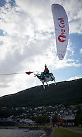 """VOSS, 2014626; Ekstremesportsweek in city of Voss in Western Norway is hosting a full week of different extreme sports ranging from skateboarding, long boarding, skydiving, rafting, paragliding and river kayaking. This photo is from the final in the MTB and BMX competitions. Here is a """"Flying cow""""-stunt performed by a paragliderpilot. PHOTO by TOM HANSEN"""