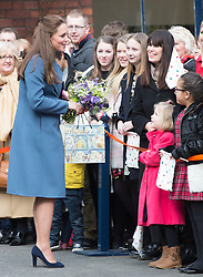 STOKE-ON-TRENT- UK- 18-FEB-2015- Catherine HRH The Duchess of Cambridge Her Royal Highness visits the Emma Bridgewater factory in Stoke no Trent. <br /> The factory will be in production of a range of mugs in support of the Nook Appeal for East Anglia's Children's Hospices, of which The Duchess is Patron. Her Royal Highness will then join families from the Donna Louise Children's Hospice in a ceramic painting workshop, before unveiling a plaque to commemorate the visit in front of assembled staff in the factory courtyard.<br /> Photograph by Ian Jones