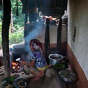 Nepal 2014. Pangma village. Nairupa cooking on an open fire.