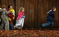JEROME A. POLLOS/Press..Jayson Berry, right, tries to catch up with the rest of his class as Jessica Isaksen, Kelin Goodson and Brandon Freeman follow close behind during Sorensen Elementary's Halloween parade on Monday.