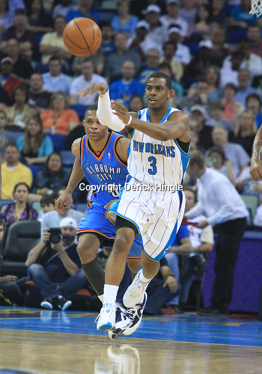 07 March 2009: New Orleans Hornets guard Chris Paul (3) passes the ball during a NBA game between the New Orleans Hornets and the Oklahoma City Thunder at the New Orleans Arena in New Orleans, Louisiana.