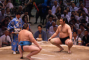 Bulgarian Kotooshu (Kaloyan Stefanov Mahlyanov; right, black mawashi) ahead of a bout with Estonian Baruto (Kaido Höövelson; left, blue mawashi) in the controversial Nagoya summer Grand Sumo Tournament held on the 14th and second final day.