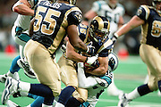 Defensive back Aeneas Williams (35) of the St. Louis Rams gets tackled by Wide receiver Steve Smith (89) of the Carolina Panthers  during a 48 to 14 win by the Rams on 11/11/2001. .©Wesley Hitt/NFL Photos
