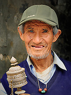 Nepal, Pokhara. Portrait of an elderly man from the tibetan refugee camp.