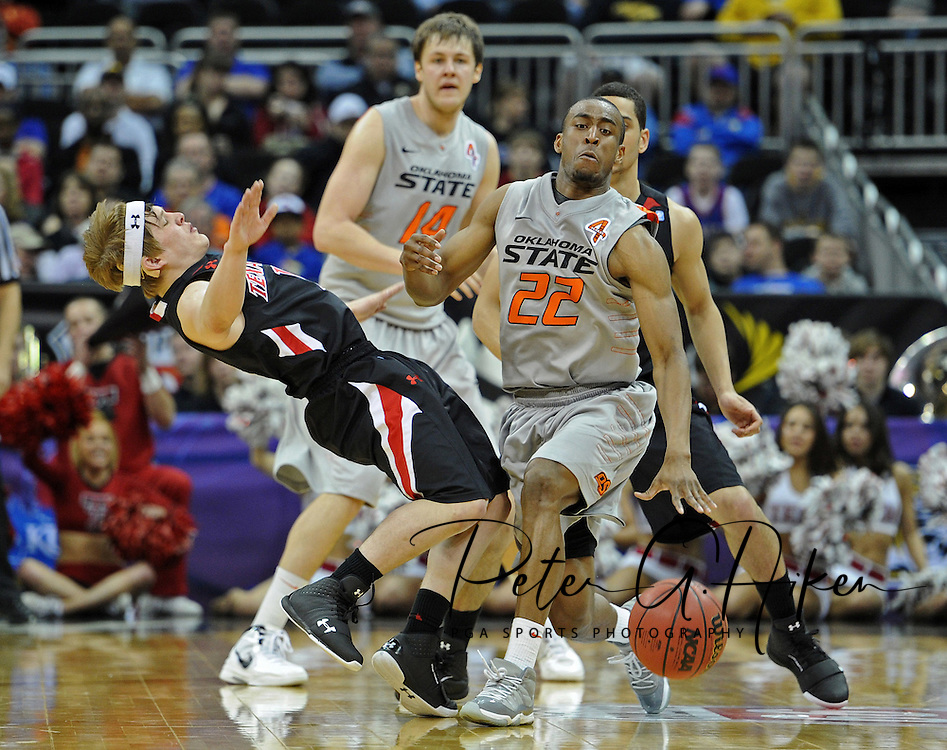 Oklahoma State Cowboys guard Markel Brown (22) drives into Texas Tech Red Raiders guard Luke Adams (13) during the first half of the first round of the Big 12 Tournament at the Sprint Center.