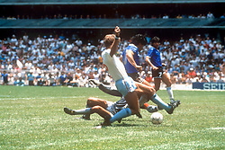 Argentina's captain Diego Maradona goes in between England's Peter Shilton and Terry Butcher to score a memorable goal.