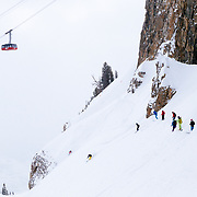 A group of female ski athletes mob skis the Expert Chutes area of Jackson Hole Mountain Resort.