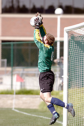 01 October 2006: Crusaders goalie stops a high kick at his goal. The game remained scoreless until the 2nd overtime in which University of Dallas Crusaders Adam Lunger scored the Golden Goal to beat the Illinois Wesleyan Titans.  This game was played at Neis Field on the campus of Illinois Wesleyan University in Bloomington Illinois.