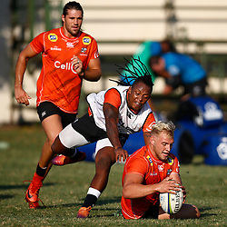 DURBAN, SOUTH AFRICA - MAY 21: S'busiso Nkosi tackling Dylan Richardson of the Cell C Sharks during the Cell C Sharks training session at Jonsson Kings Park on May 21, 2019 in Durban, South Africa. (Photo by Steve Haag/Gallo Images)