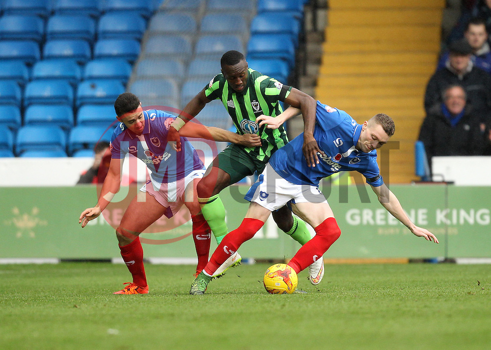 Adebayo Azeez of AFC Wimbledon battles with Caolan Lavery of Portsmouth and Gareth Evans of Portsmouth - Mandatory byline: Robbie Stephenson/JMP - 07966 386802 - 15/11/2015 - Rugby - Fratton Park - Portsmouth, England - Portsmouth v AFC Wimbledon - Sky Bet League Two