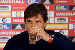 CARDIFF, WALES - Friday, August 25, 2017: Wales' manager Chris Coleman drinks a glass of water during a press conference at the Vale Resort to announce his squad for the forthcoming 2018 FIFA World Cup Qualifying Group D games against Austria and Moldova. (Pic by David Rawcliffe/Propaganda)
