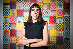 "© Licensed to London News Pictures. 15/06/2017. Wakefield UK. Picture shows Illustrator Alice Pattullo in front of her wall hanging screen printed ""quilt"", the artist has a new exhibition at the Yorkshire Sculpture park called Of House & Home which is her most ambitious project to date & includes 60 new screen printed editions revealing Pattullo's fascination with traditions, superstitions & folklore. The exhibition takes visitors on a journey through a victorian household from garden to parlour culminating with the heart of the home a recreation of a traditional fireplace & mantlepiece. Photo credit: Andrew McCaren/LNP"