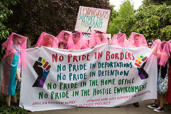 London, UK. 6 July, 2019. Activists from Lesbians and Gays Support The Migrants assemble to take part in a London Pride Solidarity March at the very rear of Pride in London - stewards tried to prevent them from joining - in solidarity with those for whom Pride in London is inaccessible and in protest against the corporatisation of Pride in London.