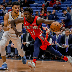 Dec 6, 2017; New Orleans, LA, USA; New Orleans Pelicans guard Jrue Holiday (11) drives past Denver Nuggets guard Jamal Murray (27) during the second half at the Smoothie King Center. The Pelicans defeated the Nuggets 123-114. Mandatory Credit: Derick E. Hingle-USA TODAY Sports