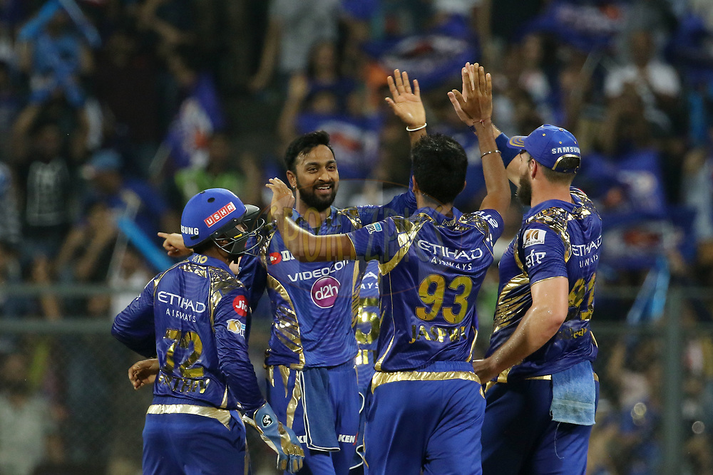 Mumbai Indians players celebrates the wicket of Yusuf Pathan of the Kolkata Knight Riders during match 7 of the Vivo 2017 Indian Premier League between the Mumbai Indians and the Kolkata Knight Riders held at the Wankhede Stadium in Mumbai, India on the 9th April 2017<br /> <br /> Photo by Vipin Pawar - IPL - Sportzpics