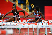 Kendra Harrison (USA), right, leads Janeek Brown (JAM) in the heats of the women's 100m hurdles during the Birmingham Grand Prix, Sunday, Aug 18, 2019, in Birmingham, United Kingdom. (Steve Flynn/Image of Sport via AP)