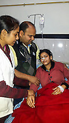 """150 ten-inch worms removed from a woman's stomach in India<br /> <br /> Indian doctors have removed more than 150 ten-inch long worms from the stomach of a woman who had been suffering excruciating stomach pain for months.<br /> <br /> Neha Begum, 22, who hails from Nai Basti in Mugalsarai district of Uttar Pradesh, had been suffering from excruciating stomach pain, vomiting and constipation for long. She had been seeing doctor in different places but none of them could diagnose the actual cause of the pain. <br /> <br /> """"When  examined her, we found something was obstructing her intestines. So we decided to open her stomach and see what was causing the obstruction. We were shocked to find live round worms wrapped around her intestine and pulled out more than 150 of them out alive. I was shocked. This was an extremely unusual case,"""" said Dr Anand Prakash Tiwari, a gynaecologist KG Nanda Hospital, Chandauli. <br /> <br /> The team of five doctors, which operated on the patient for five hours, said they had never seen a case like this before. """"It is normal to discover three or four worms inside a patient but this is the first time we have come across such a huge number,"""" said Dr Tiwari.<br /> <br /> According to hospital authorities, Neha is doing well now and was given food orally for the first time. The operation was performed a week ago.<br /> <br /> Neha, who now looks visibly relieved, says: """"I had seen several doctors before coming here, but none could diagnose what was the problem with my stomach. In the name treatment, the other doctors would give painkillers and send me back home.""""<br /> <br /> A few months after marriage, Neha developed the stomach pain that ended up affecting her married life. """"I would stay up the whole night — crying, writhing in pain. It affected our conjugal life, too. But now think we will be able to enjoy to bliss of marriage. I am very thankful to the doctors eliminating the problem for ever.""""<br /> <br /> Asked how the worms could h"""