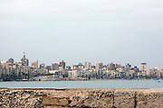 Alexandria's skyline is seen near the site of the now submerged ancient palace complex of Egyptian Queen Cleopatra February 02, 2012 in the harbor of Alexandria, Egypt. Egypt's second largest city, Alexandria is home to a population of 4 million residents. (Photo by Scott Nelson)