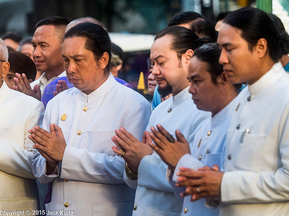 "04 SEPTEMBER 2015 - BANGKOK, THAILAND:  Brahman priests pray in front of the Erawan Shrine Friday. A ""Holy Religious Ceremony for Wellness and Prosperity of our Nation and Thai People"" was held Friday morning at Erawan Shrine. The ceremony was to regain confidence of the Thai people and foreign visitors, to preserve Thai religious customs and traditions and to promote peace and happiness inThailand. Repairs to Erawan Shrine were completed Thursday, Sept 3 after the shrine was bombed on August 17. Twenty people were killed in the bombing and more than 100 injured. The statue of the Four Faced Brahma in the shrine was damaged by shrapnel and a building at the shrine was damaged by debris.    PHOTO BY JACK KURTZ"