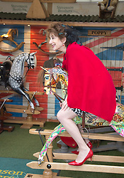 © Licensed to London News Pictures. 20/05/2013. London, England. Pictured: Actress Maureen Lipman on a rocking horse. Celebrities at Press Day Monday of the RHS Chelsea Flower Show. Photo credit: Bettina Strenske/LNP