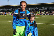Forest Green Rovers Jordan Simpson(12) with matochday mascot during the EFL Sky Bet League 2 match between Forest Green Rovers and Crawley Town at the New Lawn, Forest Green, United Kingdom on 24 February 2018. Picture by Shane Healey.