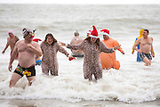 The 2016 Folkestone Lions club boxing day dip.  An annual fancy dress fundraising event, Sunny Sands, Folkestone. UK