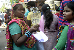 November 13, 2016 - Kolkata, West Bengal, India - A Muslim Women shows Rs. 500 and Rs. 1000 bank note and long time waiting to exchange it in front of State Bank of India.To facilitate smooth exchange and deposit the old Rs. 500 and Rs. 1000 bank note bank across India remain open for public on Sunday , as announced by Union Government after demonetized Rs.500 and Rs.1000 bank notes to tackle the menace of black money. Indian line up outside the banks to deposit and exchange demonetized bank note from late night. (Credit Image: © Saikat Paul/Pacific Press via ZUMA Wire)