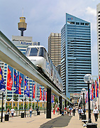 An elevated monorail travels from the central business district to Darling Harbour across Pyrmont Bridge in Sydney, New South Wales (NSW), Australia. In the 1980s, vehicular traffic was diverted over freeways further south of Cockle Bay, and Pyrmont Bridge became a pedestrian bridge in the Darling Harbour precinct.