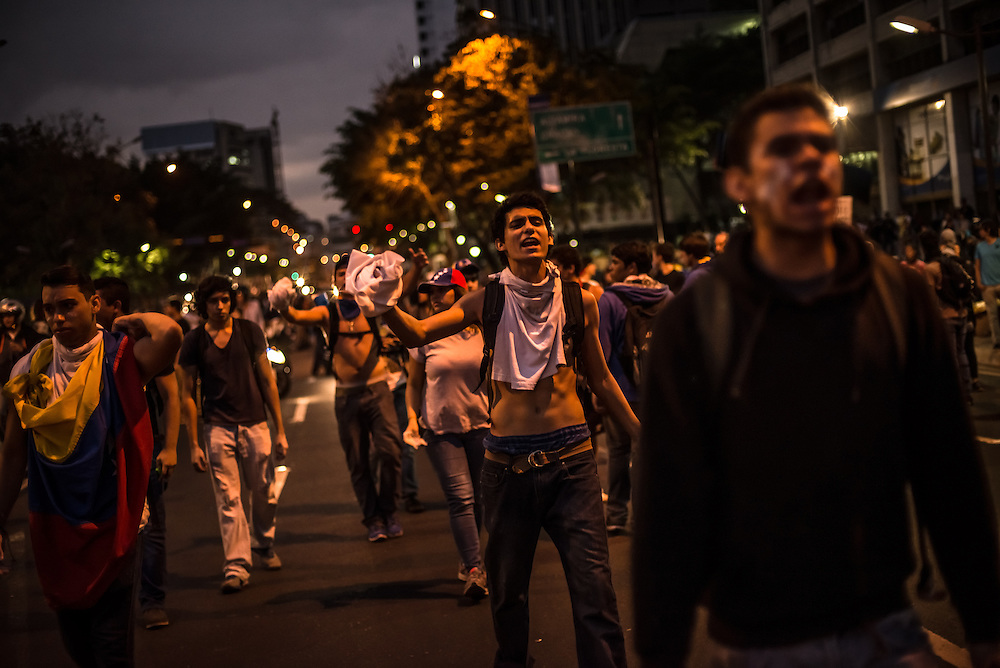 CARACAS, VENEZUELA - People across Venezuela blocked streets for several days by burning tires, scrap wood and garbage in protest against the government. Venezuela suffers from high crime, rising inflation, and shortages of basic food goods.  CREDIT: Meridith Kohut for The New York Times