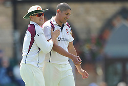 Josh Cobb of Northamptonshire celebrates with bowler Rory Kleinveldt of Northamptonshire as Graeme White of Northamptonshire catches out James Fuller of Gloucestershire for 13 - Photo mandatory by-line: Dougie Allward/JMP - Mobile: 07966 386802 - 09/07/2015 - SPORT - Cricket - Cheltenham - Cheltenham College - LV=County Championship 2