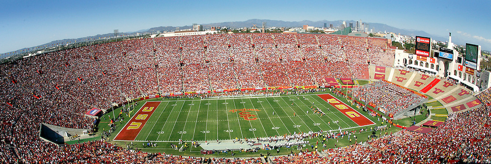 11 October 2008: NCAA Pac-10 USC Trojans 28-0 shut-out win over the Arizona State University Sun Devils during a day college football game at the Los Angeles Memorial Coliseum in Southern California. Panoramic overview of the crowded stadium during a day game.  Fans in the stands and players on the field.