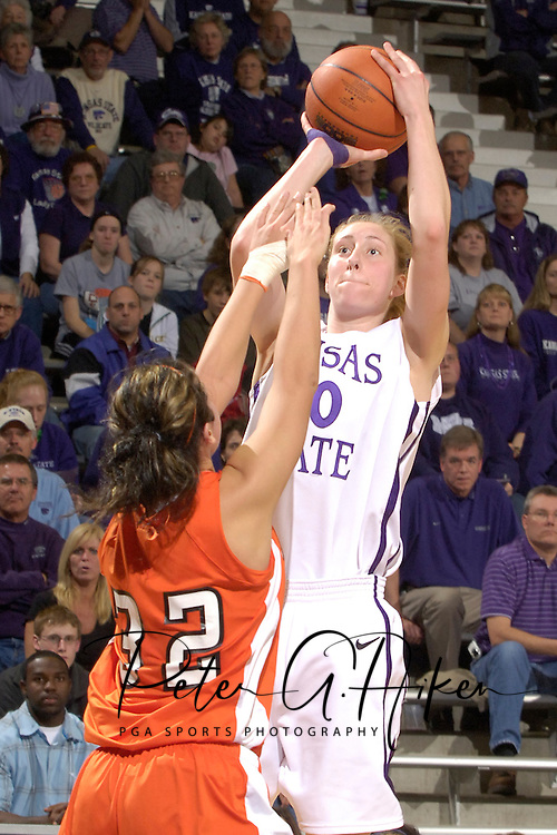 Kansas State's JoAnn Hamlin (40) fires a shot over Idaho State's Danica Boyce (32), during the second half at Bramlage Coliseum in Manhattan, Kansas, March 17, 2006.  K-State defeated the Bengals 88-68 in the first round of the WNIT.