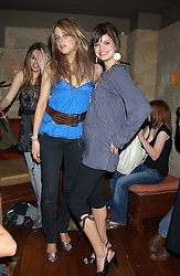 Left to right, PEACHES GELDOF and PIXIE GELDOF at a party hosted by Daniella Helayel of fashion label ISSA held at Taman Gang, 141 Park Lane, London on 15th February 2006.<br /><br />NON EXCLUSIVE - WORLD RIGHTS