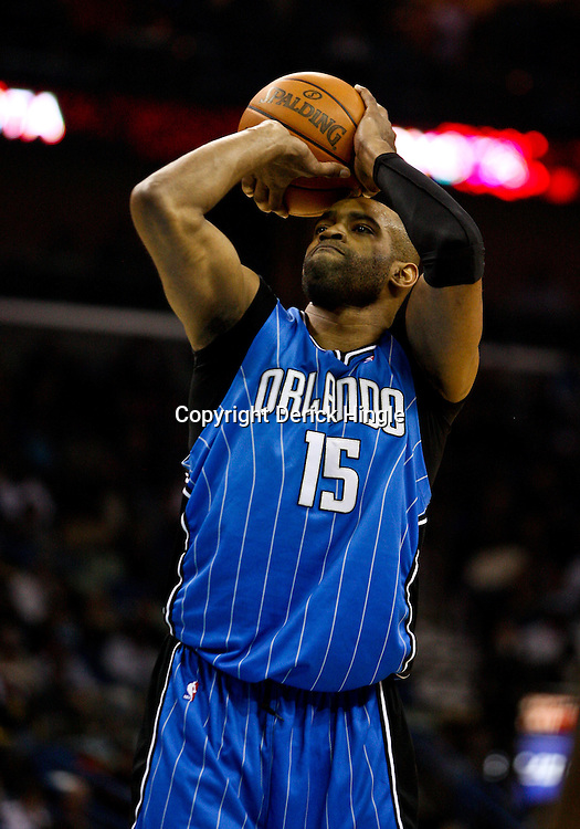 Feb 26, 2010; New Orleans, LA, USA; Orlando Magic guard Vince Carter (15) shoots against the New Orleans Hornets during the first half at the New Orleans Arena. The Hornets defeated the Magic 100-93. Mandatory Credit: Derick E. Hingle-US PRESSWIRE