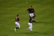PHOENIX, AZ - APRIL 30:  Jean Segura #2 of the Arizona Diamondbacks catches the fly ball as teammates Nick Ahmed #13 and Yasmany Tomas #24 watch in the fourth inning of the game against the Colorado Rockies at Chase Field on April 30, 2016 in Phoenix, Arizona.  (Photo by Jennifer Stewart/Getty Images)