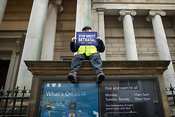 "© Licensed to London News Pictures . 05/01/2019. Manchester, UK. A man holds a "" Stop Brexit Betrayal "" placard in front of Manchester Art Gallery . A Yellow Vest demonstration takes place in St Peter's Square in central Manchester . The protest was organised via YouTube account "" Tommy Robinson News "" and was called in the wake of stabbings at Manchester Victoria Train Station on New Year's Eve . Protesters chanted in favour of Brexit , against police and press and carried pro-Trump and EDL clothing and placards . Photo credit : Joel Goodman/LNP"