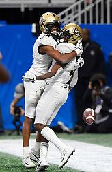 UCF Knights wide receiver Dredrick Snelson (R) celebrates his touchdown against Auburn University during the second half of the Chick-fil-A Peach Bowl NCAA college football game at the Mercedes-Benz Stadium in Atlanta, January 1, 2018. UCF won 34-27 to go undefeated for the season. (David Tulis via Abell Images for Chick-fil-A Peach Bowl)